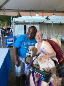 Volunteers Betty and her dog at Waterfront Blues Festival